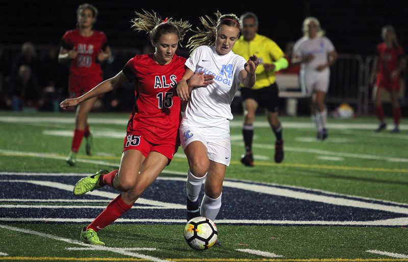 REVIEW PHOTO: MILES VANCE - Lake Oswego's Lily Sieber (left) and Lakeridge's Ashlynn Lawston battle for possession of the ball during the Lakers' 2-0 win at Lake Oswego High School on Monday.