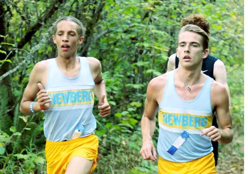 SETH GORDON - Hunter Bensman and Nathaniel Blair work their way around the course at Newberg High School Sept. 28 during a dual meet versus Tualatin. Bensman placed eighth overall to finish as Newberg's second runner, while Blair was 14th.