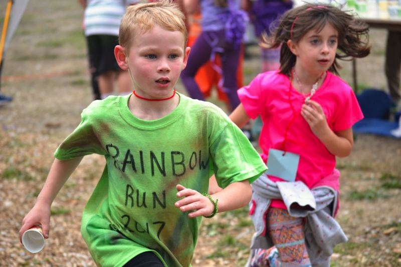 POST PHOTO: BRITTANY ALLEN - Students of Welches Elementary dress in class-coordinated colors on Friday, Sept. 29, for the school's Rainbow Run.