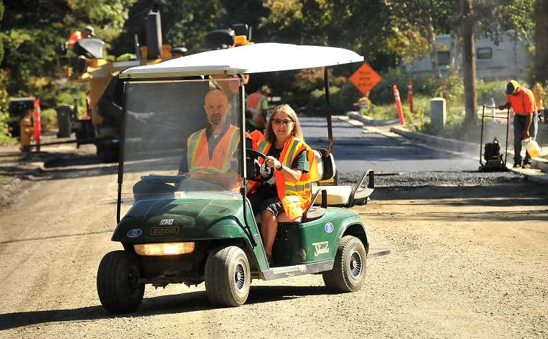 TIDINGS PHOTOS: VERN UYETAKE - City Councilor Teri Cummings and engineer Eric Lais drive up and down Kenthorpe Way looking for people in need of a shuttle during construction.