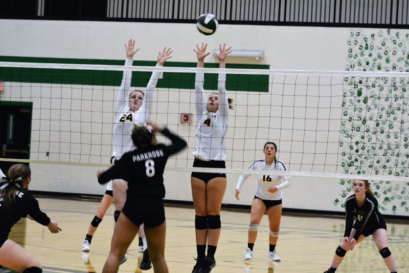 SPOTLIGHT PHOTO: JAKE MCNEAL - Lions senior middle blocker Krista Gatten (24) and junior outside hitter Natalee Webster (4) leap to defend against a shot from Parkrose senior outside hitter Tatyana Turner (8).