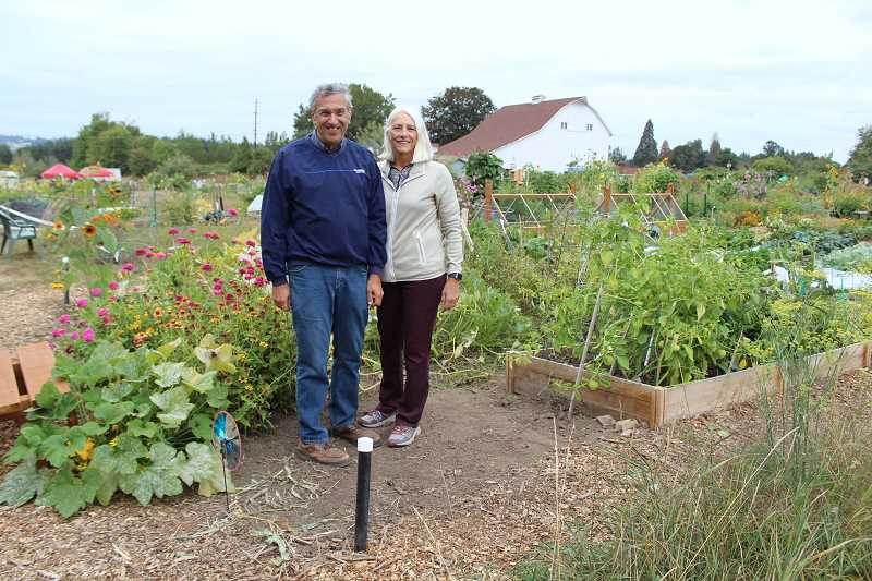 Leon and Cindy Assael pause in front of their community plot at Luscher Farm during Harvest Fest.