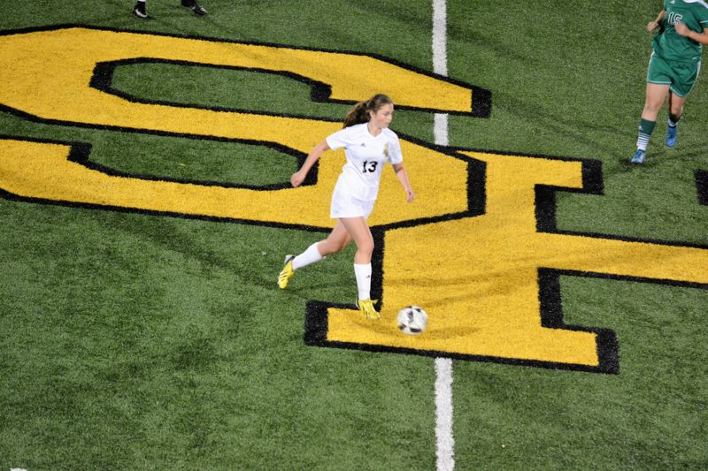 SPOTLIGHT PHOTO: JAKE MCNEAL - Lions freshman defender Lyla Beaudry (13) brings a ball across midfield.