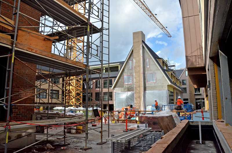REVIEW PHOTO: VERN UYETAKE - The Windward includes a central courtyard and walkways between all three buildings. According developer Patrick Kessi, 27 percent of the 2.5-acre site will be open space once the project is complete.