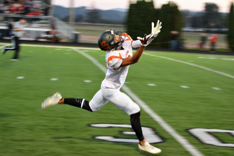SPOTLIGHT PHOTO: JAKE MCNEAL - Indians senior wide receiver Tevin Jeannis (8) reaches for a deep pass attempt.