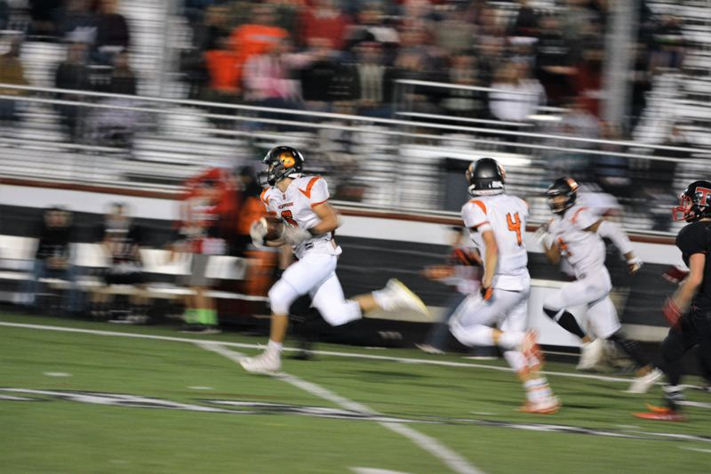 SPOTLIGHT PHOTO: JAKE MCNEAL - Indians senior running back Jack Eggers breaks loose for a long touchdown run called back for holding.