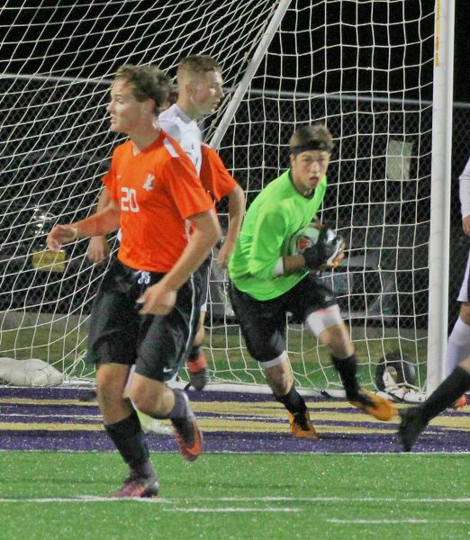 PHOTO CREDIT: JUDY REED - Junior goalkeeper Mikey Reed makes a save in the Indians' 3-1 win on Tuesday in Astoria.