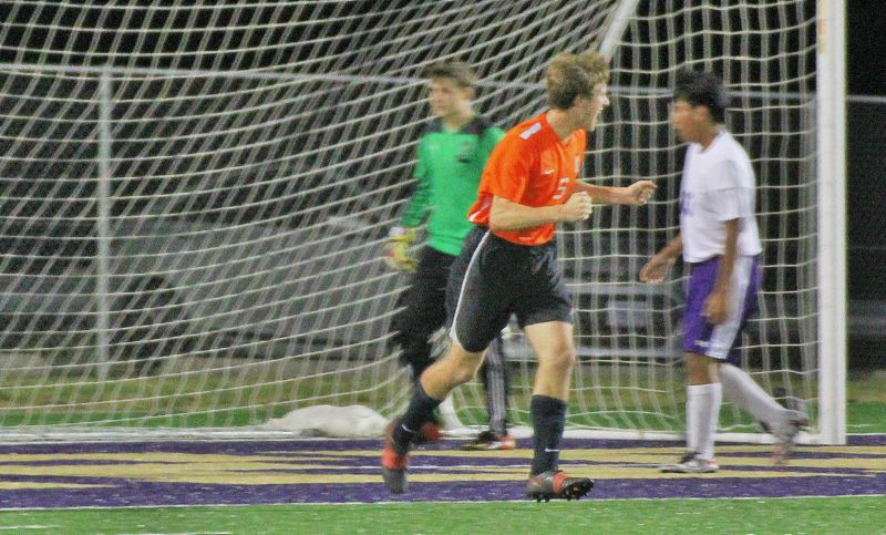 PHOTO CREDIT: JUDY REED - Indians sophomore Tyler Holcomb (5) celebrates a goal.