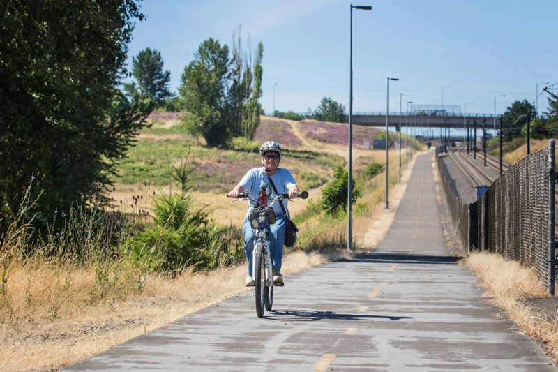 PAMPLIN MEDIA GROUP: FILE PHOTO - The largest chunk of SDC funds goes to the Parks and Rec department to expand and maintain the citys greenspace as it grows. Shown: a cyclist utilizes the Gateway Green.