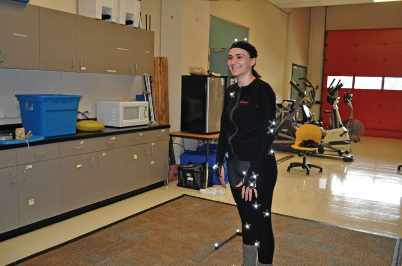 TIMES PHOTO: BLAIR STENVICK - Jennifer Meier wears a motion-capture suit to demonstrate Beaverton Health and Science School's motion-sensing cameras.