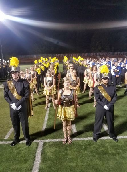 PHOTO COURTESY OF KACY HUGHSON - The St. Helens band and color guard stand at parade rest before an awards ceremony on Saturday, Sept. 30 at the Pacific Coast Invitational. The band will perform the show several more times at home football games and competitions this season.