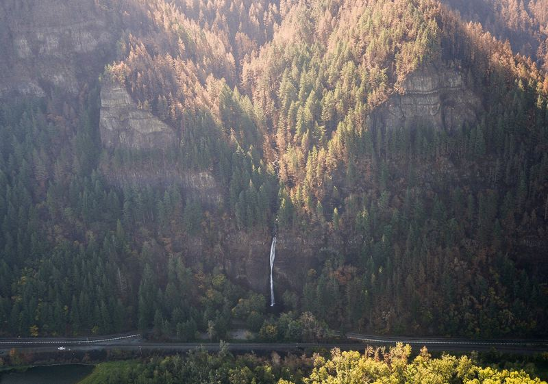 OUTLOOK PHOTO: JOSH KULLA - Tan-colored trees that still have visible foilage were burned by medium-intensity flames, which comprised 30 percent of the total burn area. This photo shows the popular Horsetail Falls State Park on the Historic Columbia River Highway.