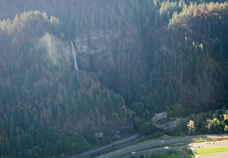 OUTLOOK PHOTO: JOSH KULLA - Multnomah Falls pours like a spigot on Tuesday, Oct. 3 in an photograph taken in a Cessna airplane operated by Envi Adventures.