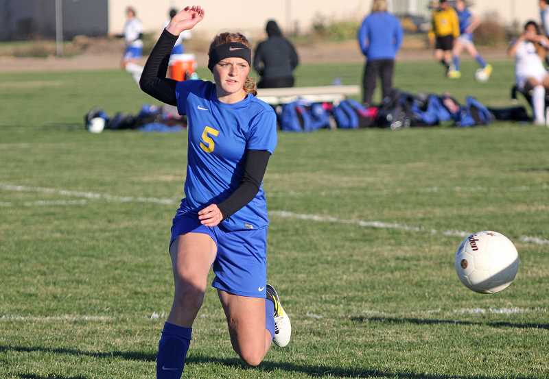 WILL DENNER/MADRAS PIONEER - Gracie Kasberger just misses on a scoring opportunity for the Cowgirls in their 4-0 loss to the Madras White Buffalos on Tuesday. Kasberger had multiple scoring chances in the match, but was unable to connect.