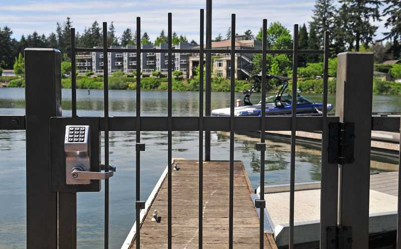 REVIEW FILE PHOTO: VERN UYETAKE - The Oregon Supreme Court agreed Friday to take up the question of whether Lake Oswego has the right to bar the public from accessing Oswego Lake. Oral arguments are scheduled for April 10, 2018.