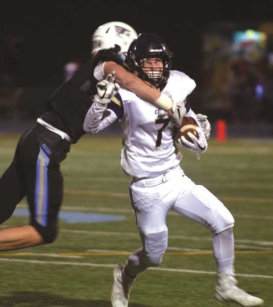 HERALD PHOTO: TANNER RUSS - Senior Joe Henry gets tackled by Pacer defense on Oct. 6 in Lakeridge.