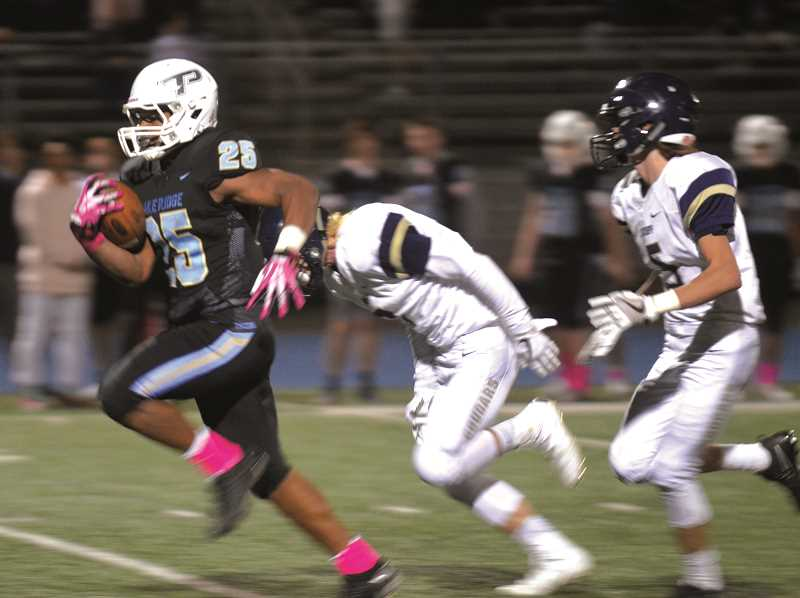HERALD PHOTO: TANNER RUSS - Lakeridge running back Jalen John scored two rushing touchdowns against Canby on Oct. 6. Lakeridge defeated the Cougars 46-14.