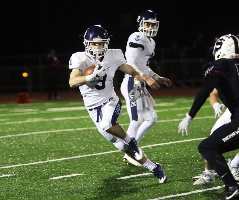 DAN BROOD - Lake Oswego sophomore running back Casey Filkins takes off with the ball during Friday's game at Sherwood.