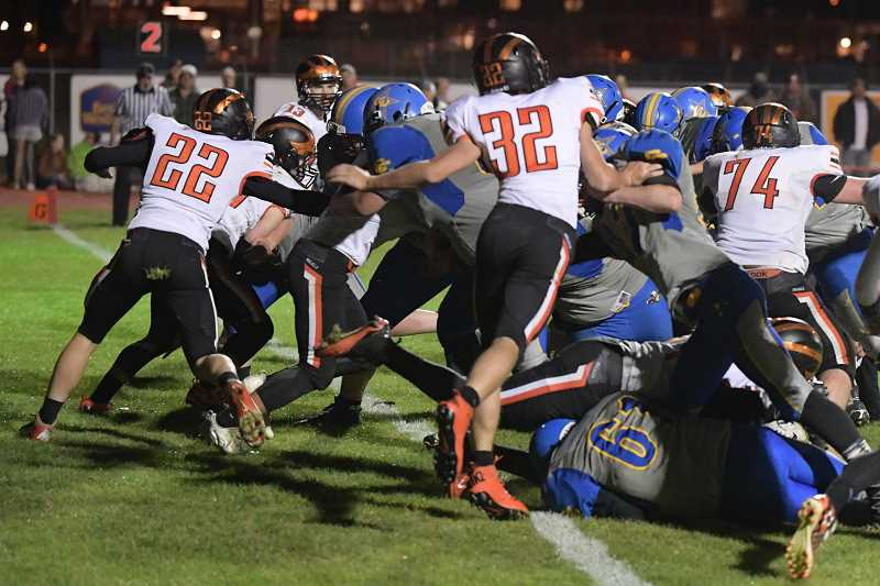 LON AUSTIN/CENTRAL OREGONIAN - Erick Gonzalez bulls his way across the goal line for a touchdown in the fourth quarter of Crook County's win over Molalla Friday night. Gonzalez scored two touchdowns in the game.
