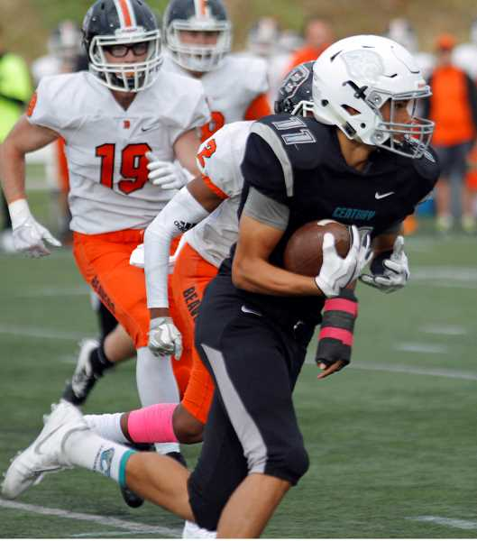 HILLSBORO TRIBUNE PHOTO: WADE EVANSON - Century's Chase Sparks runs with the ball after a catch during the Jaguars' game against Beaverton Oct. 6 at Hillsboro Stadium.