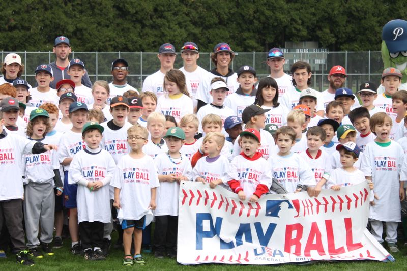 TRIBUNE PHOTO: LYNDSEY HEWITT - Children gathered at Walker Stadium in Southeast Portland's Lents Park to participate in a free baseball clinic.