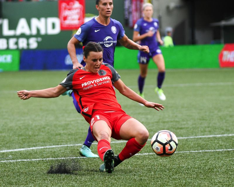 TRIBUNE PHOTO: JOSH KULLA - Hayley Raso makes a play on the ball for the Portland Thorns during their 4-1 National Women's Soccer League semifinal victory Saturday afternoon over the Orlando Pride at Providence Park.