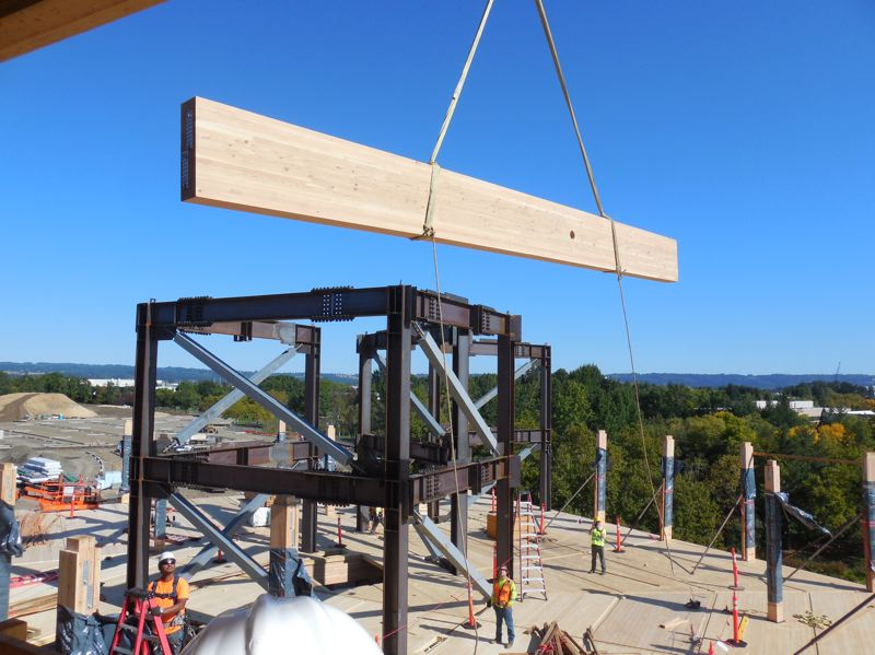 PAMPLIN MDEIA GROUP: JOSEPH GALLIVAN  - A mass timber beam being set at First Tech Federal Credit Unions site in Hillsboro.