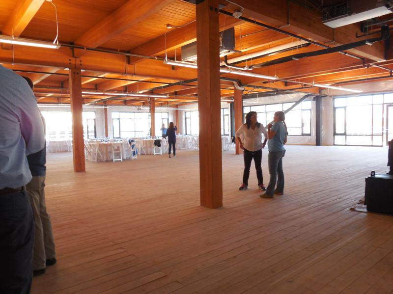 PAMPLIN MEDIA GROUP: JOSEPH GALLIVAN - Inside the Con-way Leland James Center, Northwest 22nd Ave. and Raleigh St. The former Con-Way headquarters has been gutted to expose the original beams and tongue and groove flooring, and a wooden penthouse has been added to the roof. The developer is aiming for creative office space that helps companies attract and keep talent.