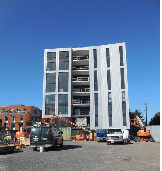 PAMPLIN MEDIA GROUP: JOSEPH GALLIVAN - Carbon12, a mass timber condo project at N. Williams Ave. and Fremont St. Al componenets arrived on 12 flatbed trucks and floors went up in days not week like post tension concrete.
