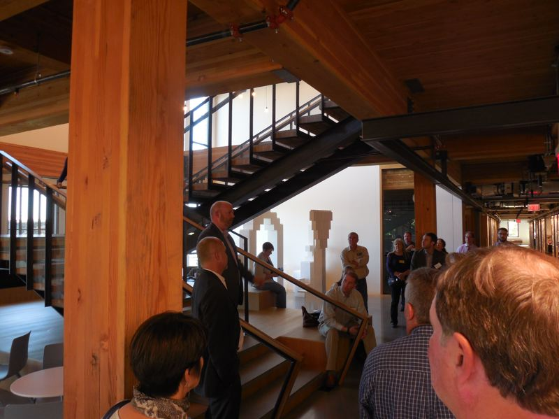 PAMPLIN MEDIA GROUP: JOSEPH GALLIVAN  - 38 Davis is a mixed use building made from mass timber from the gorund up. It is home to its own designer Ankrom Moisan Architects. Murray Jenkins explained that the only steel beam is one supporting the very heavy materials library.