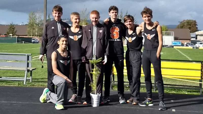 PHOTO CREDIT: SCAPPOOSE CROSS COUNTRY - From left, Gustavo Villalvazo, John Kavulich, Caleb Peckover, Jordan Buchanan, Josh Lull, Josiah Oliver and Isaiah Ebert ran to fourth with 136 points behind Siuslaw (60), Cottage Grove (110) and Philomath (111).