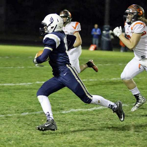 COURTESY PHOTO: STEWART MONROE - Banks' Hayden Vandehey runs away from Scappoose defenders during a game at Banks High School Oct. 6. Vandehey had five touchdown passes in the game.