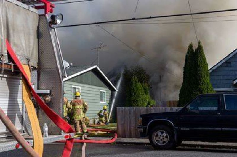PHOTO COURTESY OF MIKE GRAHAM - Columbia River Fire and Rescue crews responded to a house fire in the 100 block of Little Street on Saturday, Oct. 7. The two-story home involved in the fire was declared a total loss.