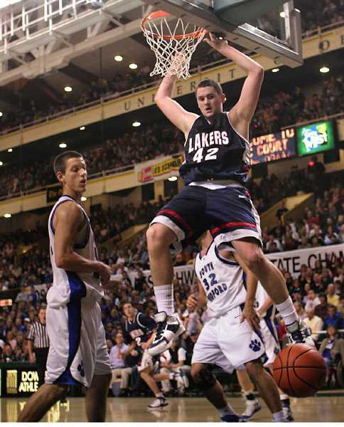 REVIEW FILE PHOTO: DAVID PLECHL - Kevin Love slam-dunks an alley-oop pass in the second half of Lake Oswego High's 2006 state championship win over South Medford. This week, Love offered to give back to his alma mater with a donation of $200,000 in strength-training equipment.