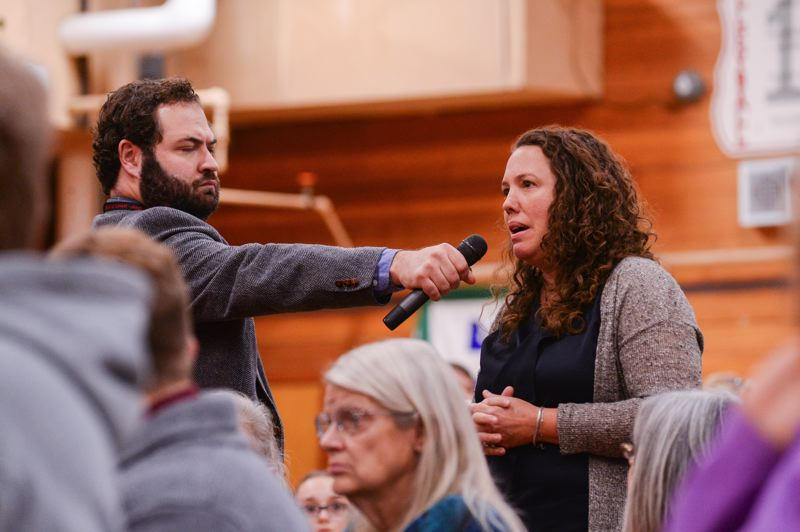 OUTLOOK PHOTO: JOSH KULLA - A member of the crowd addresses Sen. Ron Wyden during a town hall in Corbett on Monday, Oct. 9.
