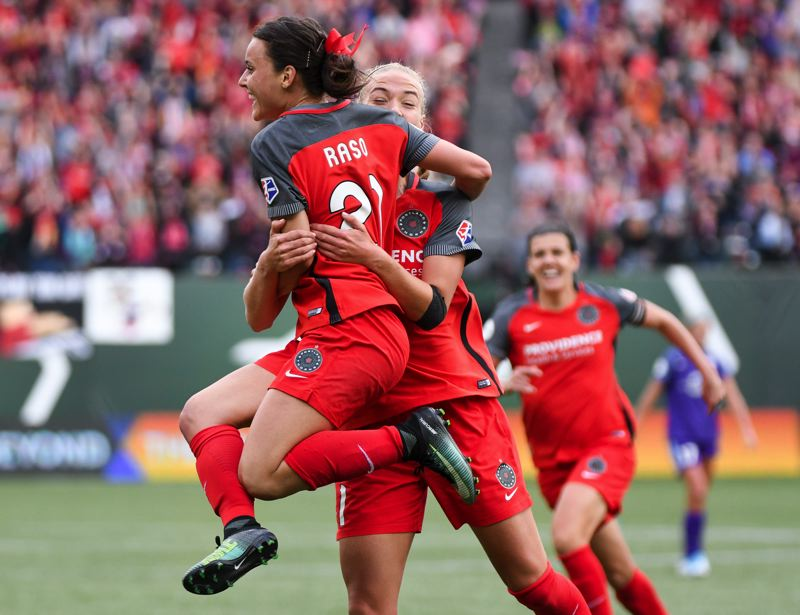 TRIBUNE PHOTO: DEIGO G. DIAZ - Hayley Raso (21) is hugged by Dagny Bryjarsdottir after scoring the third Portland goal in Saturday's 4-1 playoff win over Orlando.