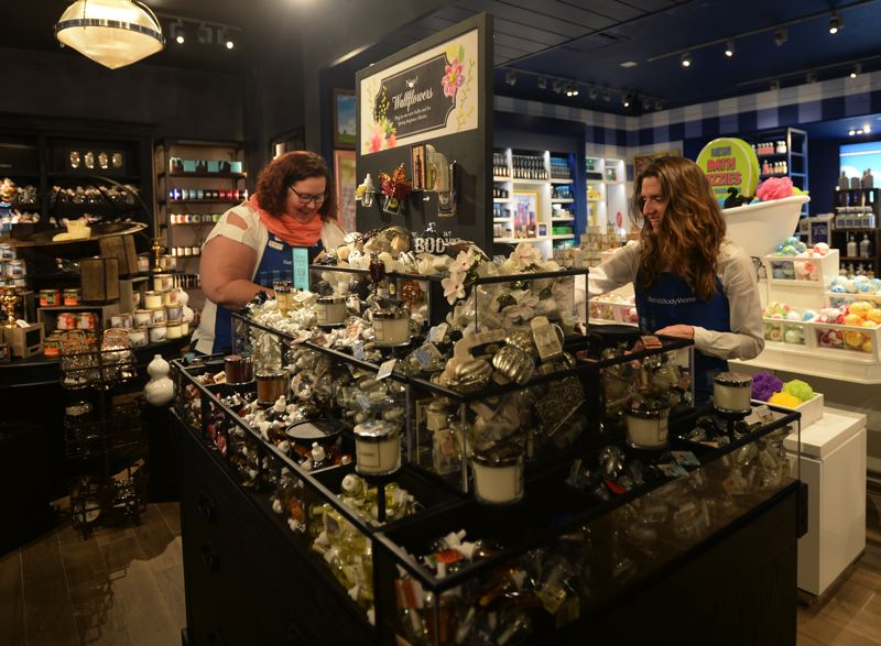 OUTLOOK PHOTO: JOSH KULLA - Bath & Body Works employees Stephanie Haley and Kisha Bayly stock shelves during a recent morning shift. The store is among the top grossing businesses in the mall.