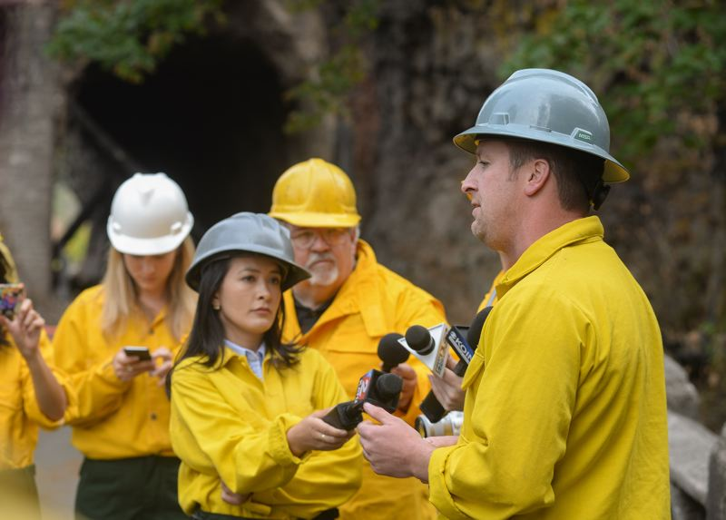 OUTLOOK PHOTO: JOSH KULLA - Geologist Ryan Cole speaks with reporters outside Oneonta Tunnel in the Columbia River Gorge on Friday, Oct. 6.