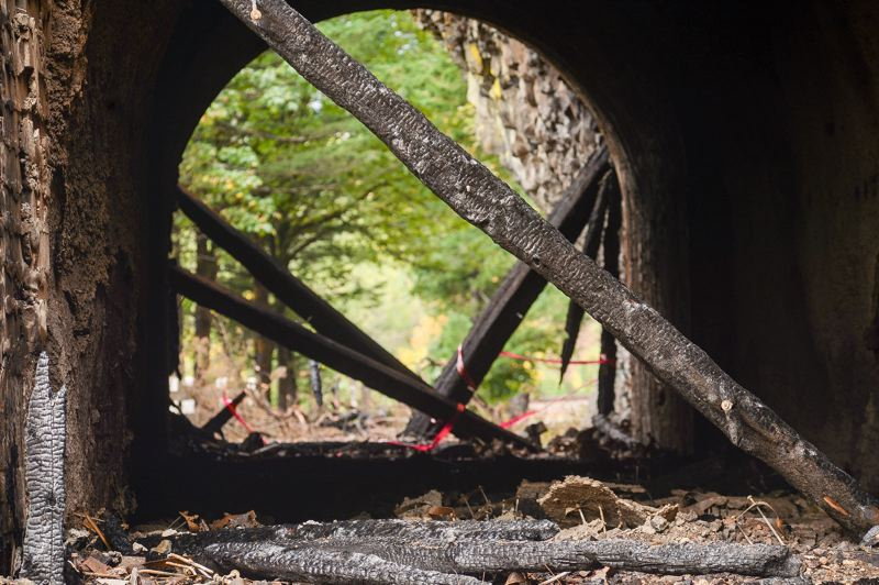 OUTLOOK PHOTO: JOSH KULLA - Charred timbers show the damage inflicted on the historic Oneonta Tunnel in the Columbia River Gorge. The tunnel was reframed relatively recently, though construction of the passage dates back to 1915.