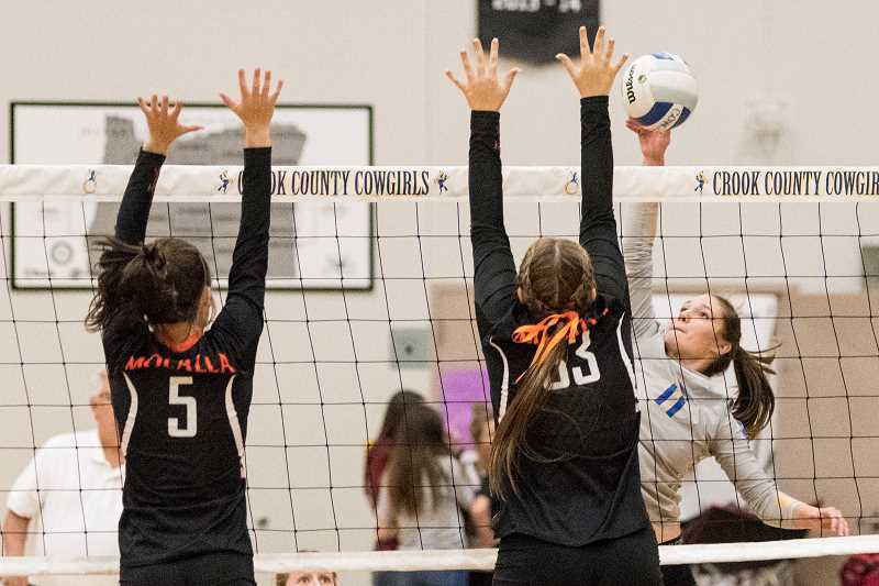 LON AUSTIN/CENTRAL OREGONIAN - Liz Barker goes up for a shot against Molalla earlier this year. The Cowgirls defeated the Indians Thursday night in Molalla. The win coupled with an Estacada loss gave the Cowgirls sole possession of first place in the Tri-Valley Conference.