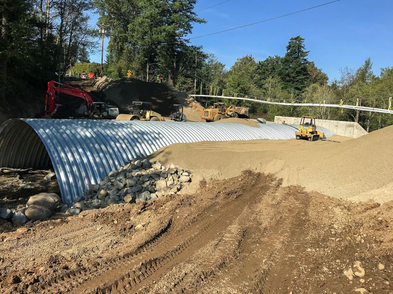 CONTRIBUTED PHOTO - The backfill pictured here has filled in a 30-foot-deep hole that was necessary to rebuild the culvert beneath Southeast Stark Street.