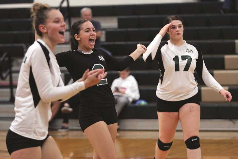 PHIL HAWKINS - North Marion senior Ally Umbenhower (center) and the Huskies celebrate during the team's 1-1 draw against No. 10 Scappoose during pool play for the 12-team North Marion volleyball tournament on Saturday. The Huskies went on to defeat No. 4 Tillamook and advance to the tournament semifinals.