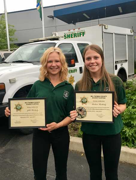 SUBMITTED PHOTO: GITTE VENDERBY - Gitte (left) and daughter Andrea Venderby pose after receiving their search and rescue certifications from the Multnomah County Sheriffs Office last September. The pair have given more than 400 hours to training and missions over the past year.