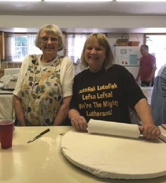 COURTESY PHOTO: IMMANUEL LUTHERAN - Lefse, a Norwegian flatbread, has become an autumn staple of Immanuel Lutheran church. Above, volunteers roll out the bread.