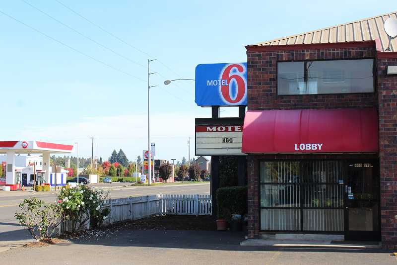 HERALD PHOTO: KRISTEN WOHLERS - A temporary Motel 6 sign went up over the old Canby Country Inn sign on Tuesday, Oct. 10.