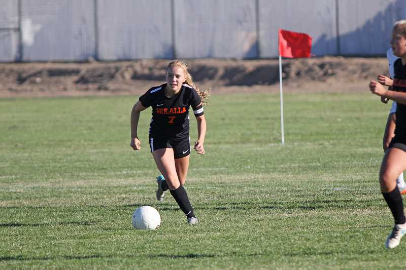PAMPLIN MEDIA GROUP PHOTO: WILL DENNER - Molalla senior Sierra Cox dribbles the ball down the field during the Indians' 2-0 win at Madras last Thursday.