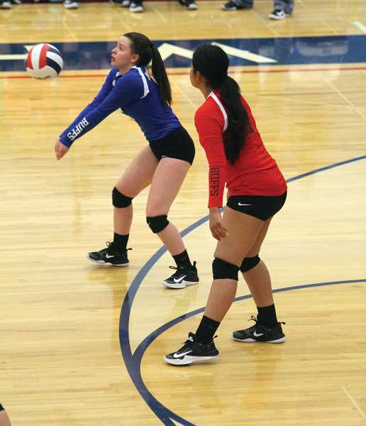 WILL DENNER/MADRAS PIONEER - Madras sophomore Korie Johnson (left) stepped into the role of libero against Gladstone for the first time this season and made the most of it.