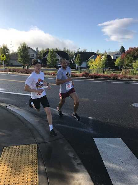 COURTESY PHOTO - Quincy Norman and Adrian Shipley were among the top finishers in the 5K race, along with Hannah Aguirre.
