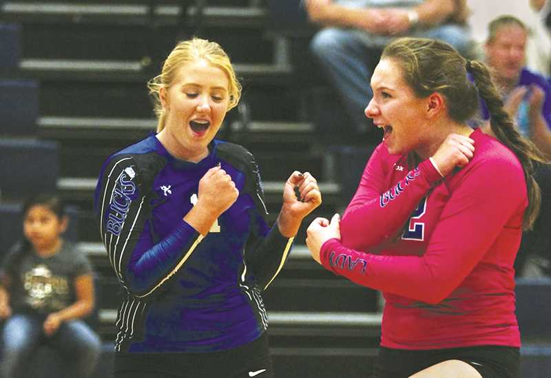 PHIL HAWKINS -- WOODBURN INDEPENDENT - Karlee Southerland and Emma Connor celebrate a point Oct. 5 during St. Paul's 3-2 road loss to Kennedy. The Bucks bounced back with wins over top-10 teams Heppner and Weston-McEwan on Saturday.