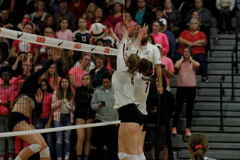HILLSBORO TRIBUNE PHOTO: WADE EVANSON - Glencoe's Caroline McArthur and Rache Adgers attempt to block a Southridge spike during their game Oct. 10 against the top-ranked Skyhawks.